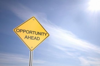 """road sign in front of blue sky, that says """"Opportunity ahead"""""""