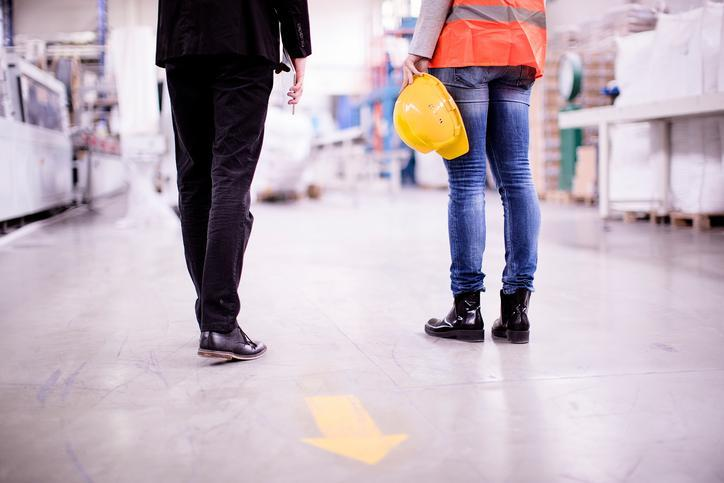 close up of the legs of people standing in warehouse environment