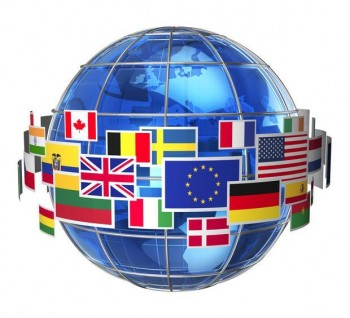 Globe with international flags circling it.