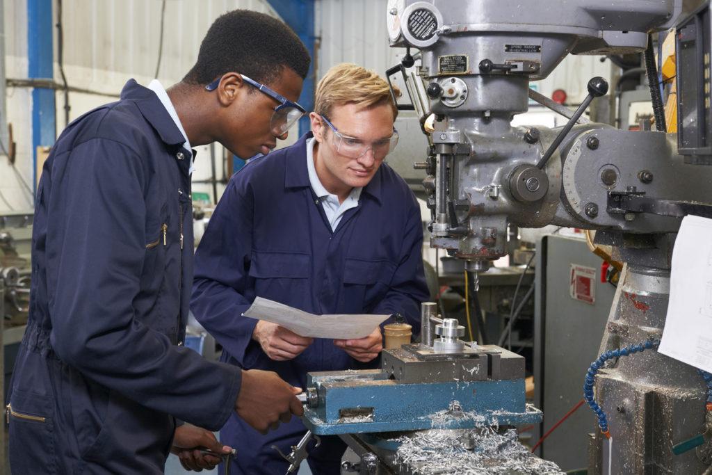 men working on a machine