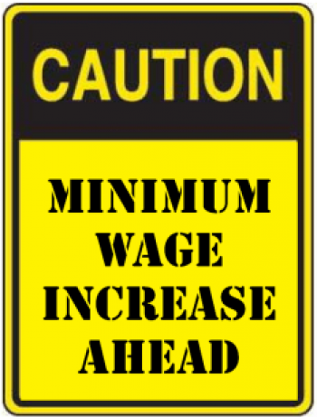 "caution sign with text ""minimum wage increase ahead"""