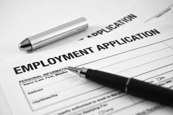 Employment application form with pen