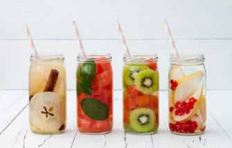 glass jars filled with fruit and water