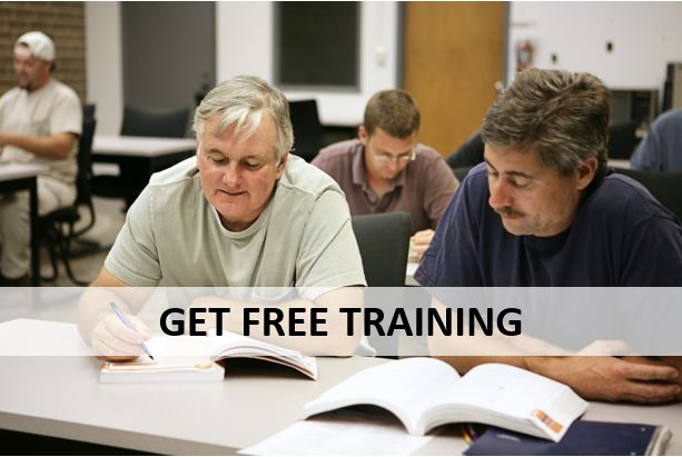 """2 men studying in a classroom and text that says """"Get free training"""""""
