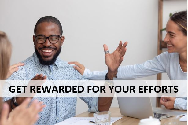 """man being cheered on by colleagues at a meeting table and text that says """"Get rewarded for your efforts"""""""