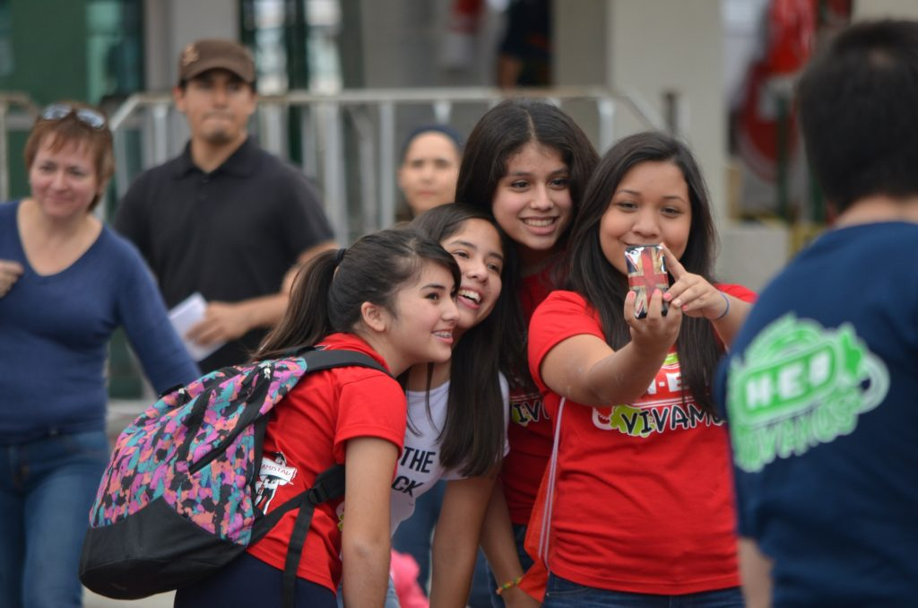 pre-teen students posing for a selfie