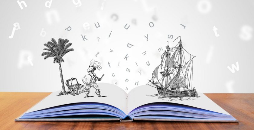 open book with illustration of pirate, palm tree and pirate ship
