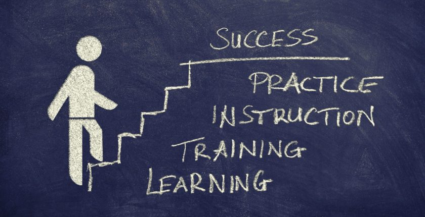chalk drawing of a stick figure climbing steps and text that says learning, training, instruction, practice, success