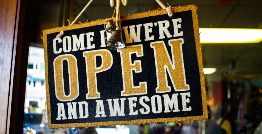 """Store window sign that says """"Come In We're Open and Awesome"""""""