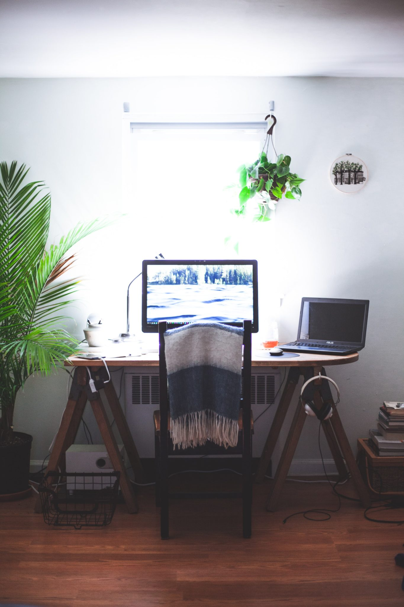 home office workspace with laptop and desk