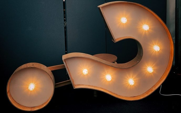 lighted electric sign in shape of a question mark