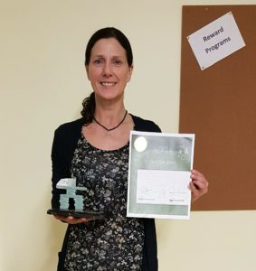 Sue holding her award plaque