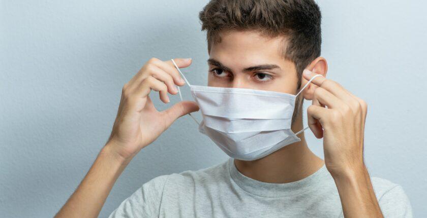 Man puts on medical mask