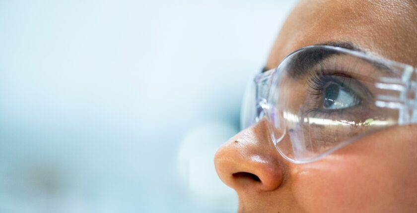 side profile of woman wearing safety goggles